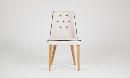 White leather dining chair with wooden legs by Urvission Interiors price £314