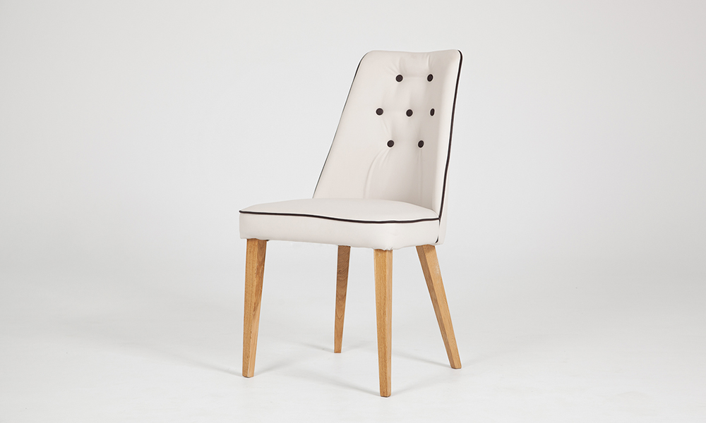 Classical white leather dining chair with wooden legs by Urvission Interiors price £314