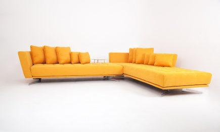 Orange modern corner sofa with steel legs size 350/270cm by Urvission Interiors price £3626