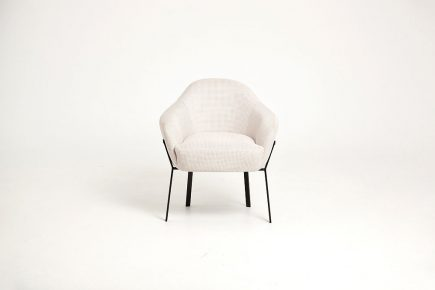 Designer beige fabric armchair with steel legs size 70/68/79 by Urvission Interiors price £399