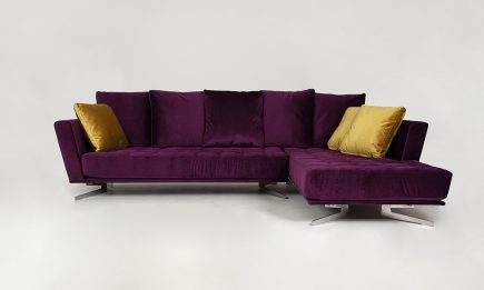 Designer purple fabric corner sofa with yellow pillows and steel legs size 315/205cm by Urvission Interiors price £3229
