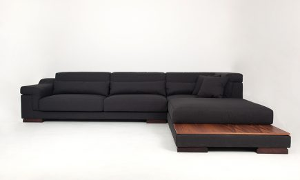 Designer black fabric corner sofa with wooden table in size 370/260 cm by Urvission Interiors price £3492