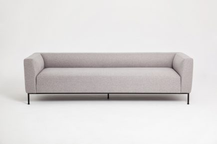 Designer 2 seat sofa in a light grey fabric with elegant black steel legs in size 140/70cm by Urvission Interiors price £1390