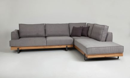 Designer grey fabric corner sofa with wood elements and elegant black steel legs in size 300/230cm by Urvission Interiors price £2833