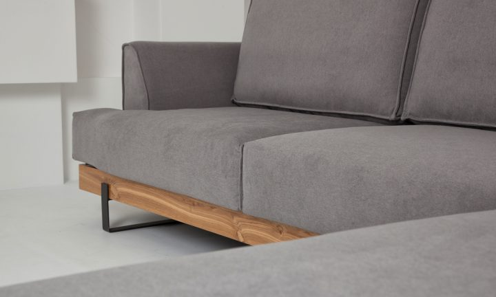 Luxury grey fabric corner sofa with wood elements and elegant black steel legs in size 300/230cm by Urvission Interiors price £2833