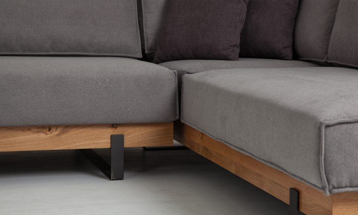 Bespoke grey fabric corner sofa with wood elements and elegant black steel legs in size 300/230cm by Urvission Interiors price £2833