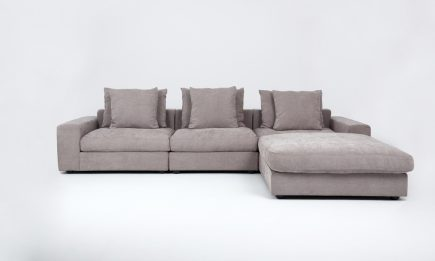 Bespoke corner sofa in light grey fabric and feathers fillng in size 350/120 cm by Urvission Interiors price £3699