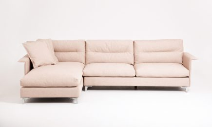Fabric corner sofa in beige upholstry and steel legs size 300/170 cm by Urvission Interiors price £2746