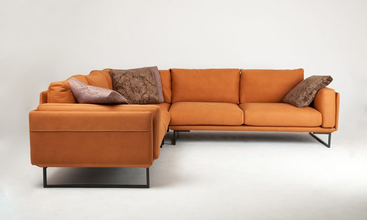 Leather corner sofa in a orange color and steel legs size 280/250 cm by Urvission Interiors price £3239