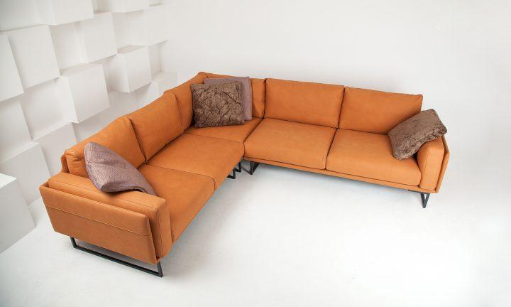Designer leather corner sofa in a orange color and steel legs size 280/250 cm by Urvission Interiors price £3239