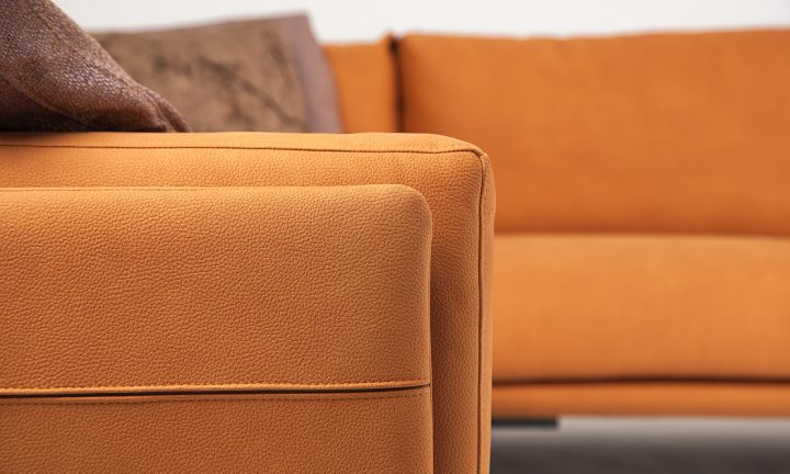 Luxury leather corner sofa in a orange color and steel legs size 280/250 cm by Urvission Interiors price £3239