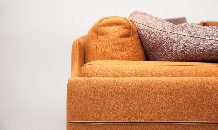 Bespoke leather corner sofa in a orange color and steel legs size 280/250 cm by Urvission Interiors price £3239