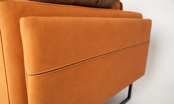 Comfortable leather corner sofa in a orange color and steel legs size 280/250 cm by Urvission Interiors price £3239