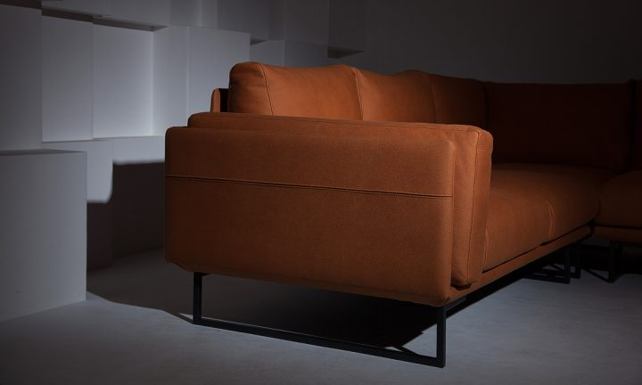 Cozy leather corner sofa in a orange color and steel legs size 280/250 cm by Urvission Interiors price £3239