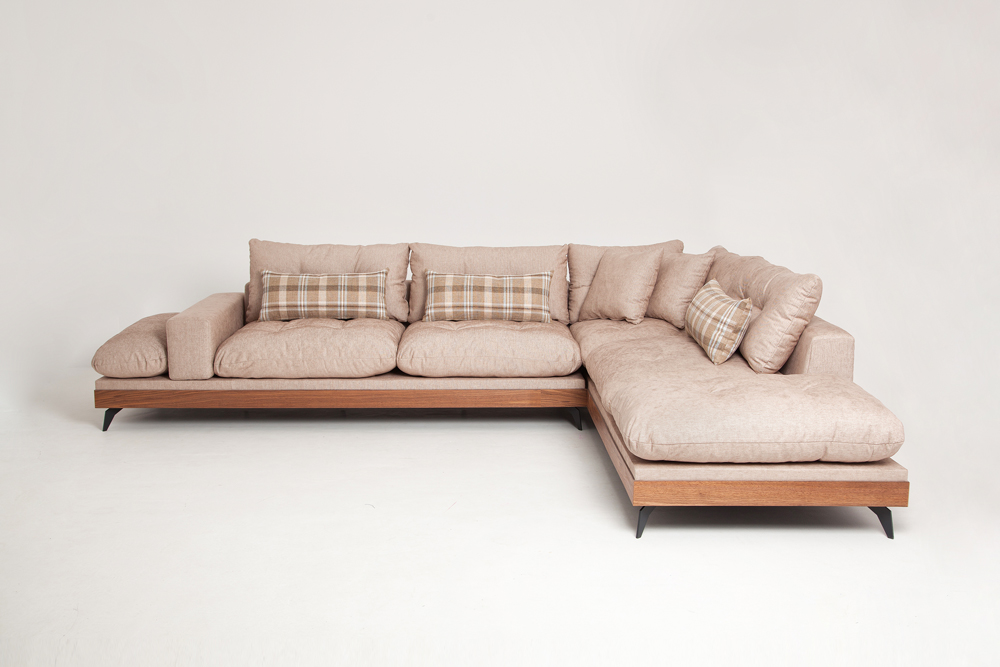 Bespoke modern corner sofa in a beige fabric with wooden base and steel legs size 340/250cm by Urvission Interiors price £2922