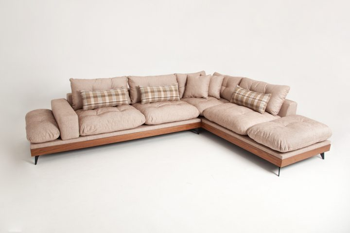 Bespoke corner sofa in a beige fabric with wooden base and steel legs size 340/250cm by Urvission Interiors price £2922