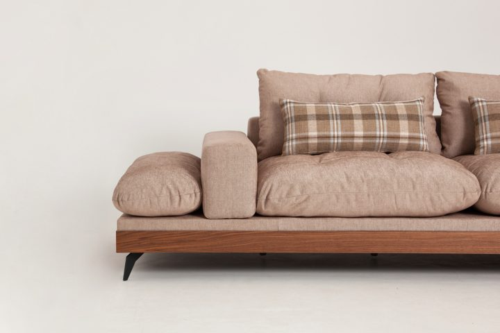 Designer corner sofa in a beige fabric with wooden base and steel legs size 340/250cm by Urvission Interiors price £2922