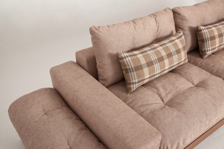 Fabric corner sofa in a beige colour with wooden base and steel legs size 340/250cm by Urvission Interiors price £2922