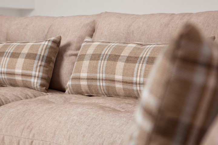 Cozy corner sofa in a beige colour with wooden base and steel legs size 340/250cm by Urvission Interiors price £2922