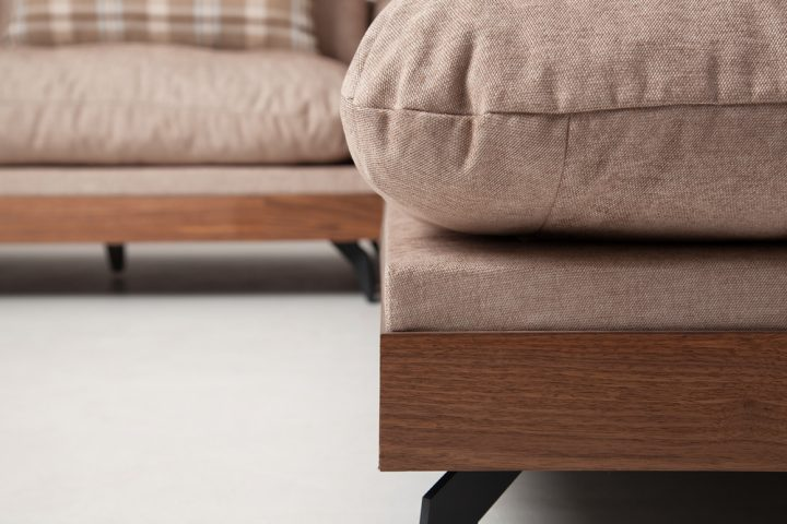 Corner sofa in a beige colour with wooden base and steel legs size 340/250cm by Urvission Interiors price £2922