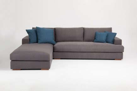 Corner sofa in a luxury grey fabric and blue cushions size 290/170 cm by Urvission Interiors price £2922