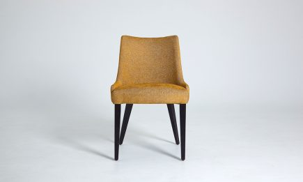 Luxury upholstered dining chair in a mustard fabric and wood legs size 55/55/83 cm by Urvission Interiors price £223