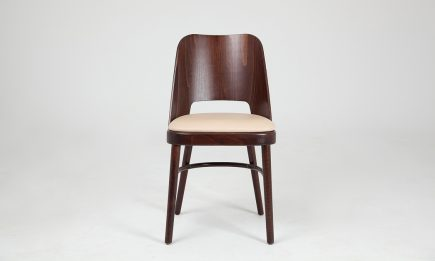 Brown wood dining chair and beige leather seat by Urvission Interiors price £188