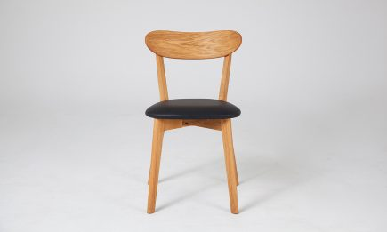 Wood dining chair with black leather seat by Urvission Interiors price £181