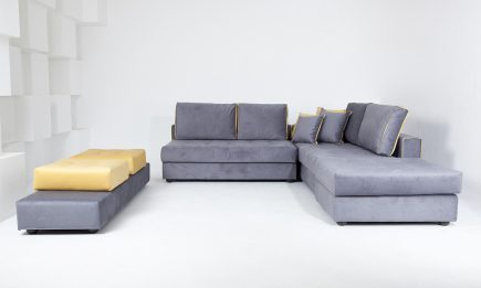 Grey corner sofa with luxury velvet fabric and yellow cushions size 250/295 cm by Urvission Interiors price £2899