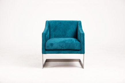 Cosy upholstered armchair in luxury blue velvet with steel legs size 69/70/77cm by Urvission Interiors price £749