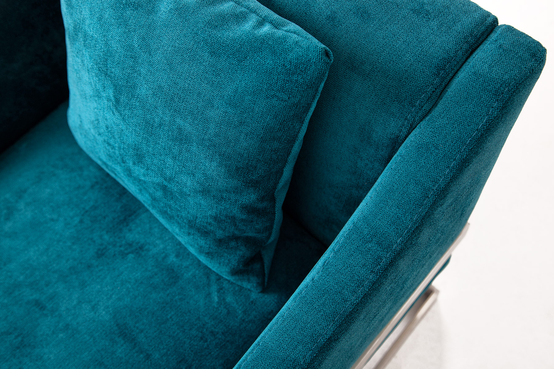 Modern blue velvet armchair with cosy cishion and steel legs size 69/70/77cm by Urvission Interiors price £749