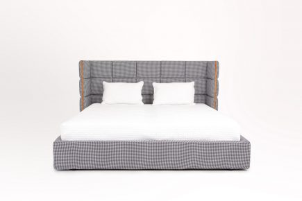 Upholstered double bed in a grey pepita fabric and hand made orange leather elements bespoke ottoman style size 160/200 cm by Urvission Interiors price £2206