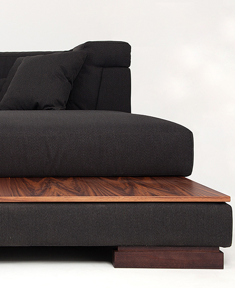 Contemporary black corner sofa whit solid wood table by Urvission Interiors