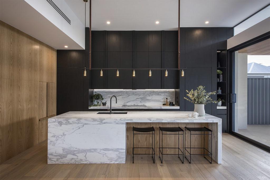 Contemporary cosy black kitchen design by Urvission Interiors