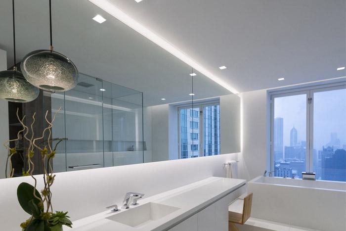 Luxury contemporary lightings of bathroom by Urvission Interiors