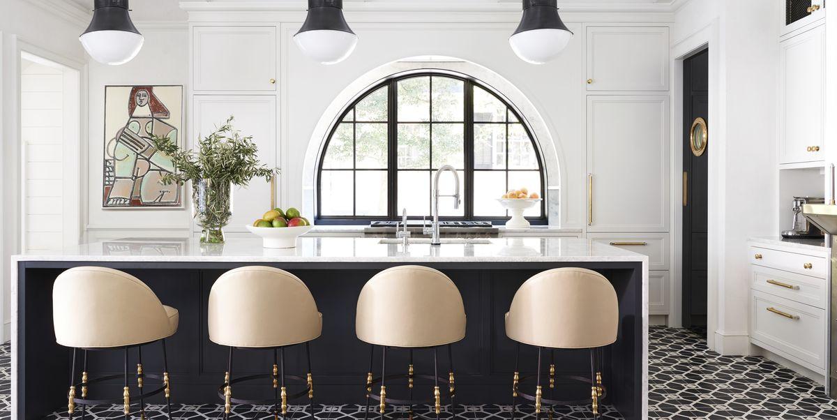 Cosy modern kitchen design by Urvission Interiorserior design living room by Urvission Interiors