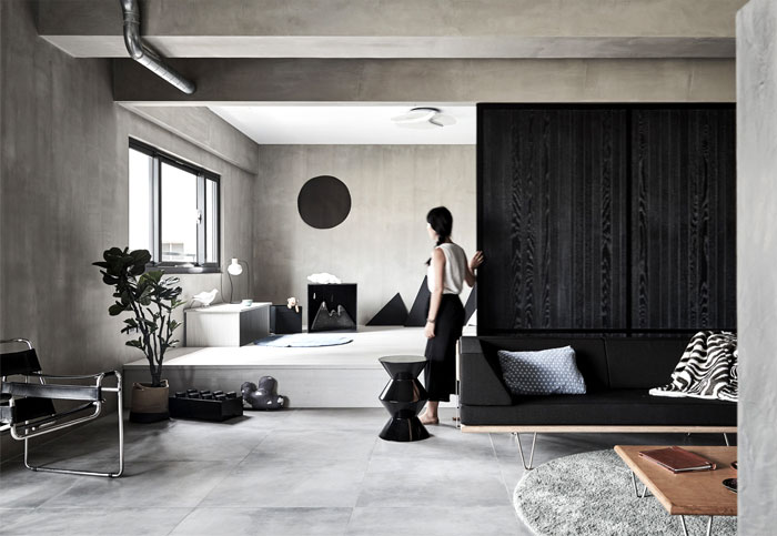 Modern industrial interior design of cosy apartment by Urvission interiors