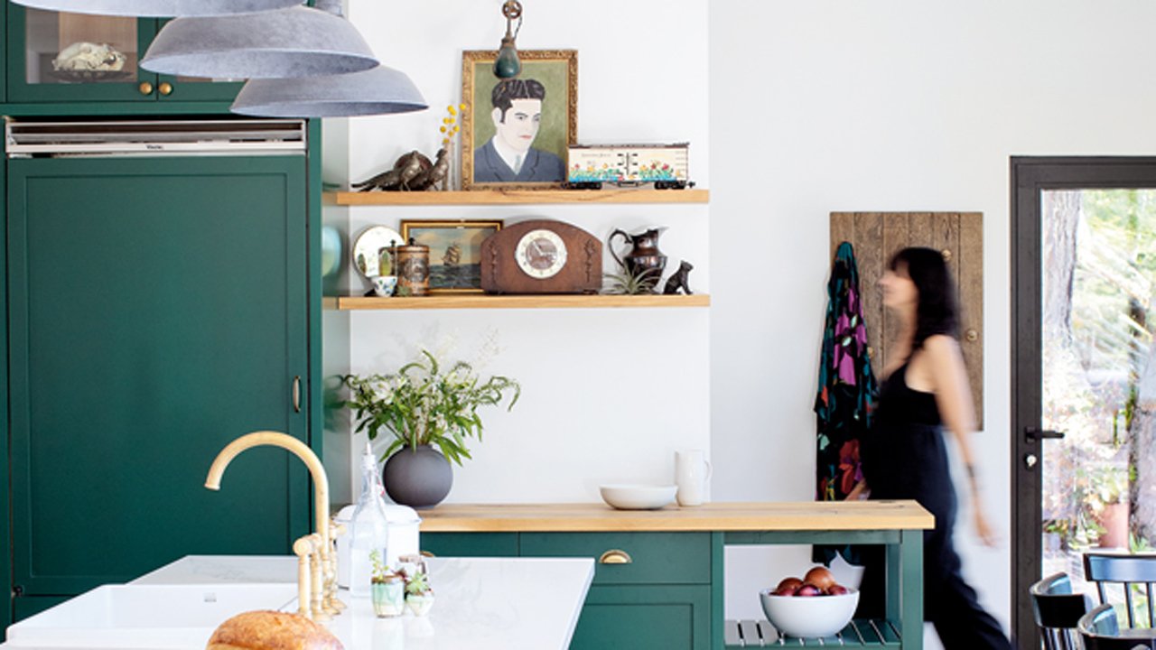 Cosy green Mid-century modern kitchen by Urvission Interiors