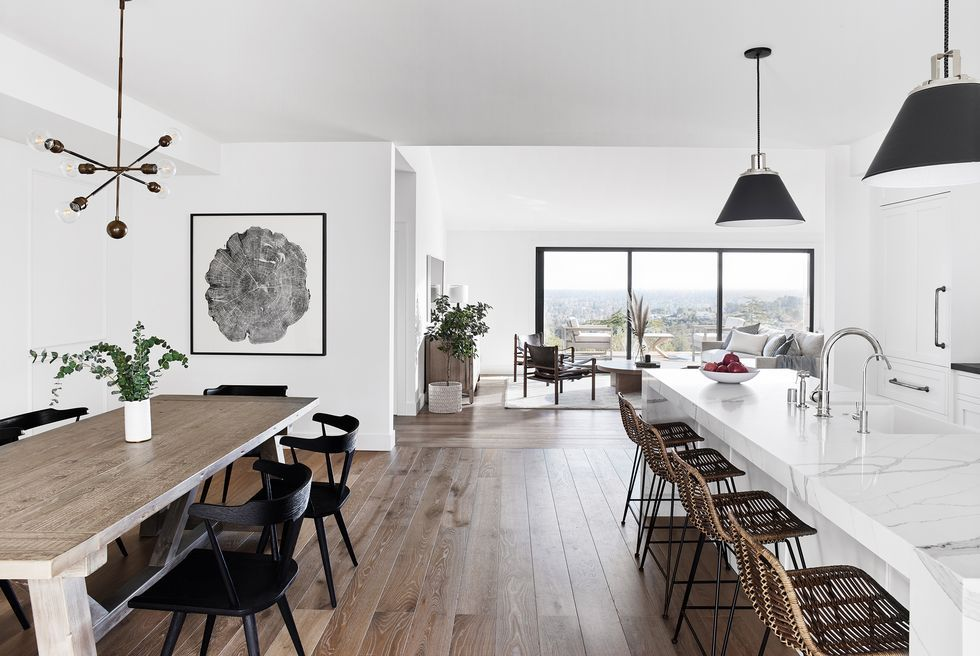 Cosy Scandinavian dinning room and kitchen by Urvission Interiors