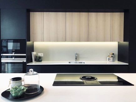 Black contemporary bespoke cooking island open plan kitchen Urvission Interiors